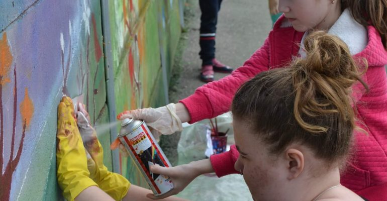Volunteers painting a wall